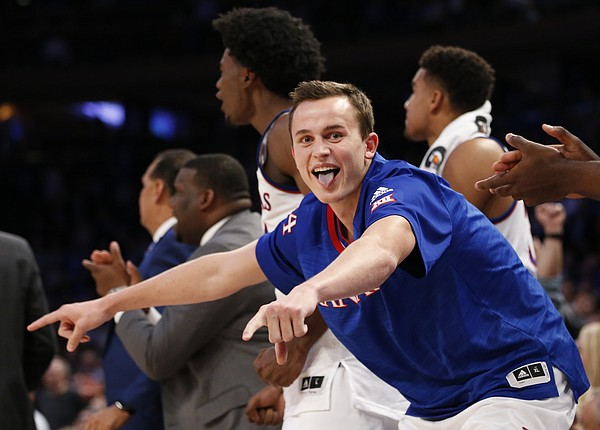 Kansas forward Mitch Lightfoot celebrates a bucket by teammate Frank Mason III during the second half of the Champions Classic on Tuesday, Nov. 15, 2016 at Madison Square Garden in New York.