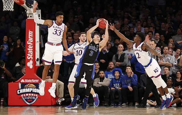 The Kansas defense tries to rip away a ball from Duke guard Grayson Allen (3) during the second half of the Champions Classic on Tuesday, Nov. 15, 2016 at Madison Square Garden in New York.
