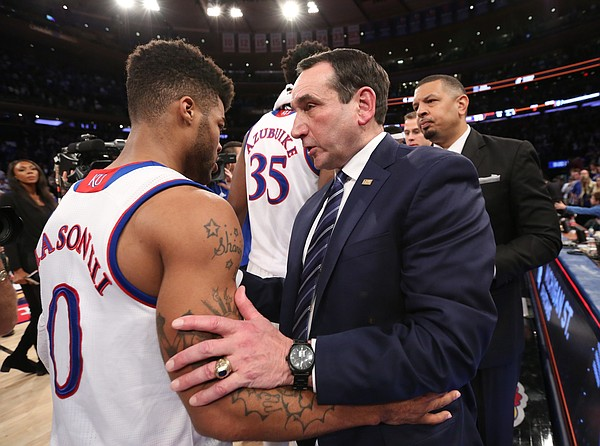 Duke head coach Mike Krzyzewski congratulates Kansas guard Frank Mason III (0) after the Jayhawks' 77-75 win.