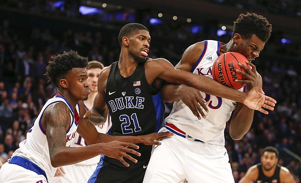 Kansas center Udoka Azubuike (35) pulls a rebound from Duke forward Amile Jefferson (21) during the second half of the Champions Classic on Tuesday, Nov. 15, 2016 at Madison Square Garden in New York. At left is Kansas guard Lagerald Vick (2).