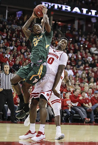 Siena's Nico Clareth (15) grabs an offensive rebound away from Wisconsin's Nigel Hayes (10) during the first half of an NCAA college basketball game Sunday, Nov. 15, 2015, in Madison, Wis.