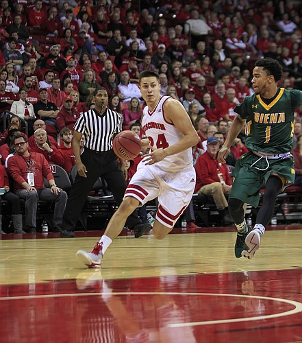 Wisconsin guard Bronson Koenig (24) and Siena's Marquis Wright (1) during the second half of an NCAA college basketball game Sunday, Nov. 15, 2015, in Madison, Wis. Wisconsin won 92-65.