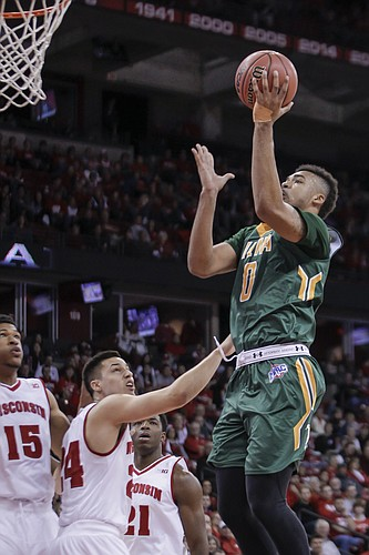 Siena's Javion Ogunyemi (0) shoots against Wisconsin's Bronson Koenig (24) during the first half of an NCAA college basketball game Sunday, Nov. 15, 2015, in Madison, Wis