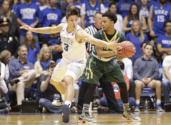 Duke's Grayson Allen defends Siena's Marquis Wright during the first half of an NCAA college basketball game in Durham, N.C., Friday, Nov. 13, 2015.