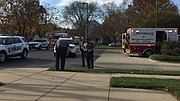 Several police officers stand in the 800 block of Tennessee Street where a man allegedly armed with a knife was arrested earlier Thursday afternoon. Before the arrest, officers used a Taser stun gun on the man.