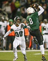 Derby senior receiver Kenyon Tabor jumps up to catch a pass in front of Free State junior cornerback Gabe del Valle during the Class 6A state semifinals on Friday.