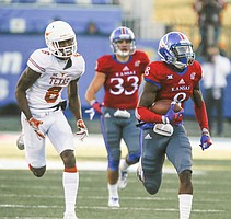 Kansas corner back Brandon Stewart runs back an interception for a touchdown during the second quarter on Saturday, Nov. 19, 2016 at Memorial Stadium.