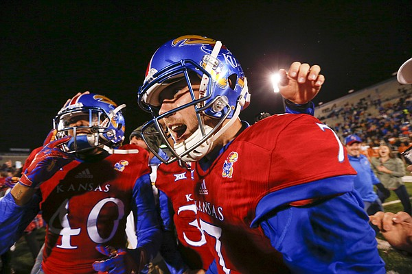 Kansas place kicker Matthew Wyman (7) celebrates with his teammates following the Jayhawks' 24-21 overtime upset of Texas on Saturday, Nov. 19, 2016 at Memorial Stadium. Wyman kicked the game-winning field goal.