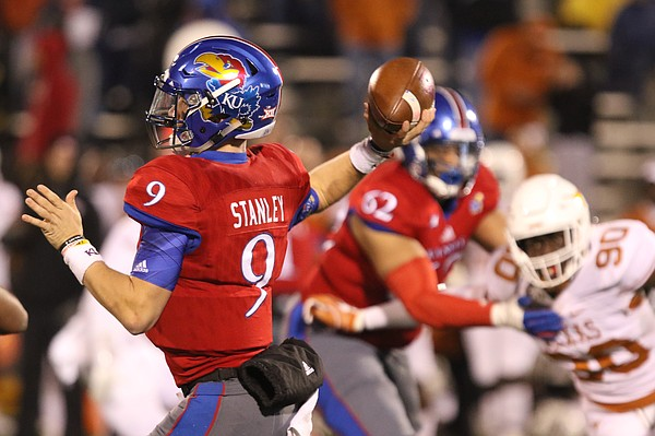 Kansas quarterback Carter Stanley (9) throws during the fourth quarter on Saturday, Nov. 19, 2016 at Memorial Stadium.