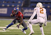 Kansas wide receiver Steven Sims Jr. (11) puts a juke move on Texas cornerback Kris Boyd (2) during the fourth quarter on Saturday, Nov. 19, 2016 at Memorial Stadium.
