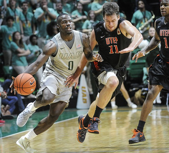 UAB guard Hakeem Baxter (0) and UTEP forward Jake Flaggert (11) race to the basket during the second half of an NCAA college basketball game, Saturday, Jan. 9, 2016, in Birmingham, Ala. UAB won 87-80.