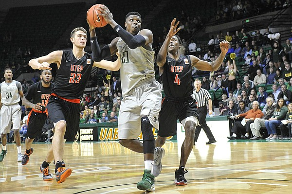 UAB forward Tosin Mehinti (21) is defended by UTEP center Hooper Vint (23), and guard Lee Moore (4) during an NCAA college basketball game, Saturday, Jan. 9, 2016, in Birmingham, Ala. UAB won 87-80.