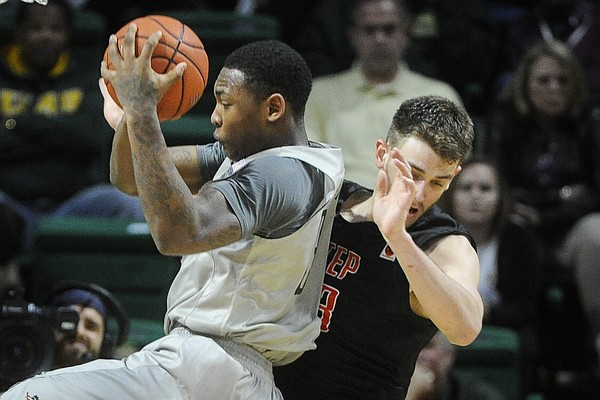 UAB forward Chris Cokley, left, comes up with a rebound in front of UTEP center Hooper Vint during an NCAA college basketball game, Saturday, Jan. 9, 2016, in Birmingham, Ala. UAB won 87-80.