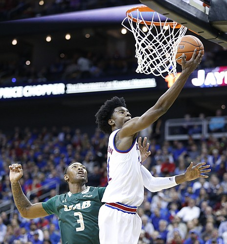 Kansas guard Josh Jackson (11) floats in for a bucket past UAB forward Chris Cokley (3) during the first half of the CBE Classic on Monday, Nov. 21, 2016 at Sprint Center.