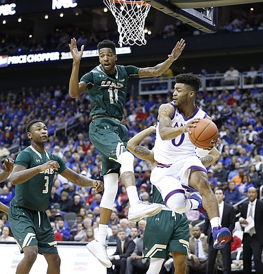 Kansas guard Frank Mason III (0) looks for an outlet under the bucket as he is defended by UAB guard Dirk Williams (11) during the first half of the CBE Classic on Monday, Nov. 21, 2016 at Sprint Center.