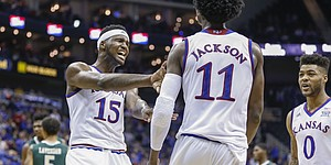 Kansas forward Carlton Bragg Jr. (15) gives a celebratory shove to Kansas guard Josh Jackson (11) after a posterizing dunk during the second half of the CBE Classic against UAB on Monday, Nov. 21, 2016 at Sprint Center. At right is Kansas guard Frank Mason III (0).