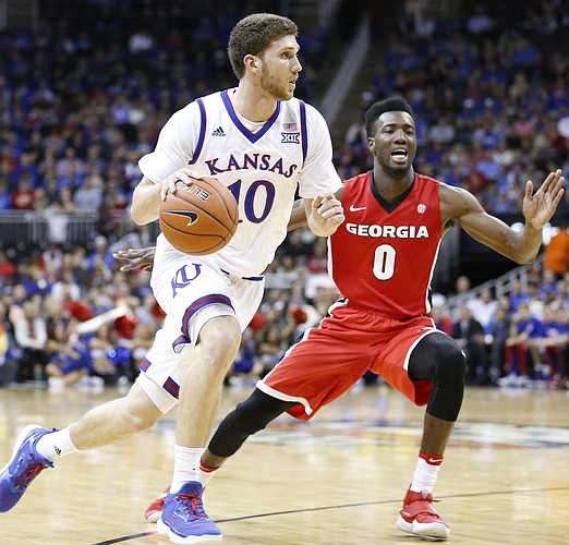Kansas guard Sviatoslav Mykhailiuk (10) drives against Georgia guard William Jackson II (0) during the first half, Tuesday, Nov. 22, 2016 during the championship game of the CBE Classic at Sprint Center.