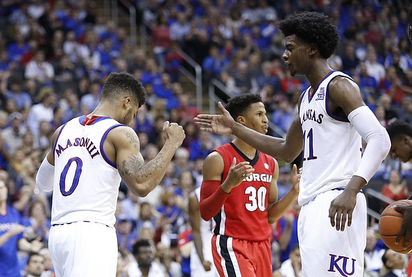 Kansas guard Frank Mason III (0) slaps hands with Kansas guard Josh Jackson (11) after getting a bucket and a foul during the second half, Tuesday, Nov. 22, 2016 during the championship game of the CBE Classic at Sprint Center.