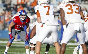 Kansas' Keith Loneker Jr. lines up across from Texas quarterback Shane Buechele and running back D'Onta Foreman during the first quarter of the Jayhawks' 24-21 win over the Longhorns on Saturday, Nov. 19, 2016 at Memorial Stadium.