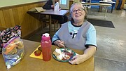 Mary Louise Taylor, of Lawrence, eats a Thanksgiving meal provided by LINK on Nov. 24, 2016.