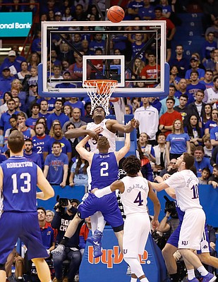 Kansas center Udoka Azubuike (35) rejects on of his 3 blocked shots against UNC Asheville forward Alec Wnuk (2) in the Jayhawks 95-57 win against UNC Asheville Friday night, Nov. 25, in Allen Fieldhouse.