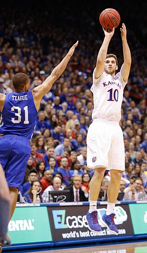 Kansas guard Sviatoslav Mykhailiuk (10) shoots in one of his two three-point baskets in the Jayhawks 95-57 win against UNC Asheville Friday night, Nov. 25, in Allen Fieldhouse.