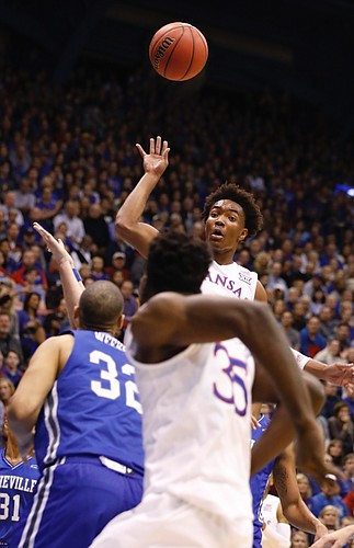 Kansas guard Devonte' Graham (4) looks a pass to Kansas center Udoka Azubuike for a dunk in the Jayhawks win against UNC Asheville Friday night, Nov. 25, in Allen Fieldhouse. Graham lead KU players with 11 assists.