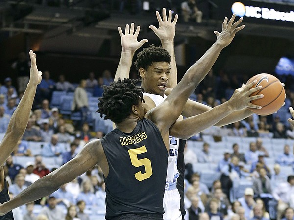 North Carolina's Isaiah Hicks reaches for the ball past Long Beach State's Mason Riggins (5) during the first half of an NCAA college basketball game in Chapel Hill, N.C., Tuesday, Nov. 15, 2016.