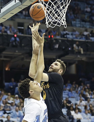 North Carolina's Justin Jackson, left, defends against Long Beach State's Gabe Levin during the second half of an NCAA college basketball game in Chapel Hill, N.C., Tuesday, Nov. 15, 2016. North Carolina won 93-67.