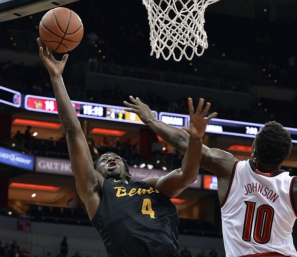 Long Beach State's Temidayo Yussuf (4) attempts a shot over the defense of Louisville's Jaylen Johnson (10) during the first half of an NCAA college basketball game, Thursday, Nov 17, 2016, in Louisville, Ky.