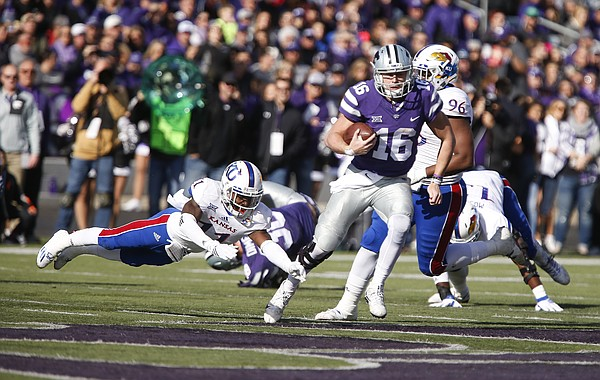 Kansas State quarterback Jesse Ertz (16) avoided a tackle from Kansas safety Mike Lee (11) during the second quarter, Saturday, Nov. 26, 2016 at Bill Snyder Family Stadium.