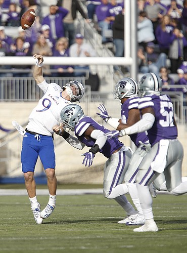 Kansas quarterback Carter Stanley (9) loses the ball as he is hit by a Kansas State defender during the fourth quarter, Saturday, Nov. 26, 2016 at Bill Snyder Family Stadium.