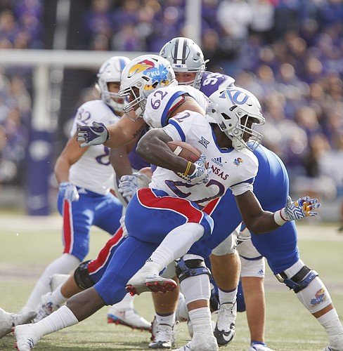 Kansas running back Ke'aun Kinner (22) tries to cut around the Kansas State defense during the fourth quarter, Saturday, Nov. 26, 2016 at Bill Snyder Family Stadium.