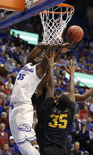 Kansas center Udoka Azubuike (35) fights for position inside during the first half, Tuesday, Nov. 29, 2016 at Allen Fieldhouse.