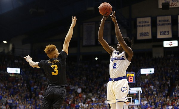 Kansas guard Lagerald Vick (2) puts up a three over Long Beach State guard Noah Blackwell (3) during the first half, Tuesday, Nov. 29, 2016 at Allen Fieldhouse.