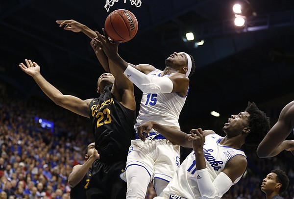Kansas forward Carlton Bragg Jr. (15) and Kansas guard Josh Jackson (11) battle for a rebound with Long Beach State forward Roschon Prince (23) during the second half, Tuesday, Nov. 29, 2016 at Allen Fieldhouse.