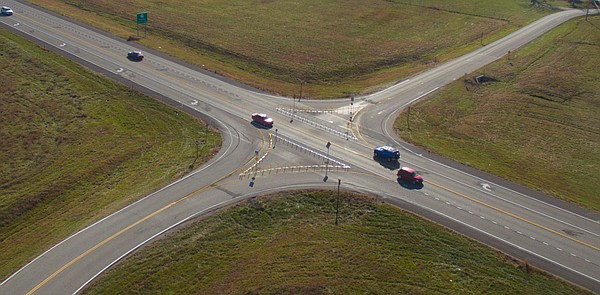 Traffic flows through the modified intersection at Kansas Highway 10 and East 1200 Road on Friday, Nov. 25, 2016. Stick-like barriers were placed on either side of the intersection to prevent motorists from crossing K-10.