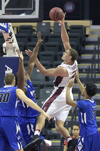 Stanford forward Reid Travis (22) goes up for a shot between Indiana State forward Matt Van Scyoc (30), forward Brandon Murphy (34) and guard Jordan Barnes (2) during the second half of an NCAA college basketball game at the AdvoCare Invitational tournament in Lake Buena Vista, Fla., Friday, Nov. 25, 2016. Stanford won 65-62.