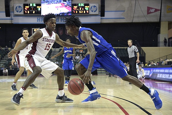 Indiana State guard Laquarious Paige (32) drives past Stanford guard Marcus Allen (15) during the second half of an NCAA college basketball game at the AdvoCare Invitational tournament in Lake Buena Vista, Fla., Friday, Nov. 25, 2016. Stanford won 65-62.