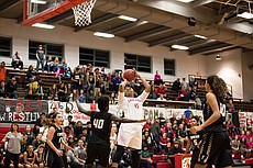 Lawrence High sophomore center Chisom Ajekwu (45) pulls up for a jump shot in the 2nd quarter in the Lions' season opener against Topeka on Friday at LHS.