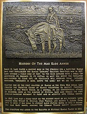 This bronze plaque by Lawrence artist Andy Foat was created to note the history of the Max Kade Annex at 1132 W. 11th St. The oldest building on the University of Kansas campus, the native stone structure was originally built in 1862 as a stable on property owned by James H. Lane, a prominent abolitionist and one of Kansas' first senators after statehood. It's now part of KU's Max Kade Center for German-American Studies, which is located in the former Sudler House adjacent to the annex.