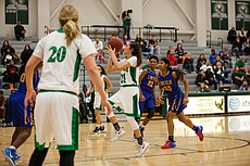 Free State guard Jaelyn Two Hearts prepares to shoot a running jumper against Lincoln Prep on Saturday at FSHS.
