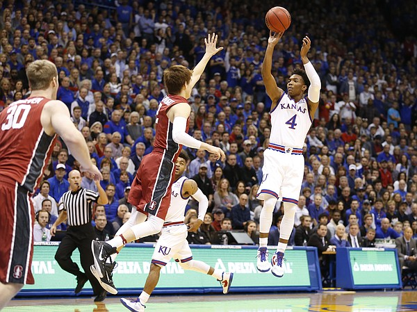 Kansas guard Devonte' Graham (4) puts up a three during the first half on Saturday, Dec. 3, 2016 at Allen Fieldhouse.
