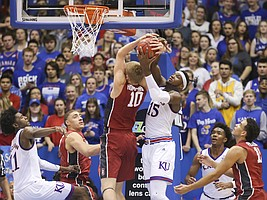 Kansas forward Carlton Bragg Jr. (15) and Stanford forward Michael Humphrey (10) fight for a rebound during the first half on Saturday, Dec. 3, 2016 at Allen Fieldhouse.