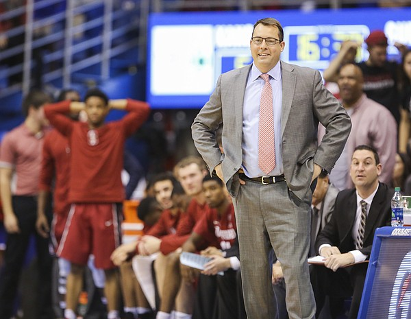 Stanford head coach Jerod Haase smiles during a Kansas run in the second half on Saturday, Dec. 3, 2016 at Allen Fieldhouse.