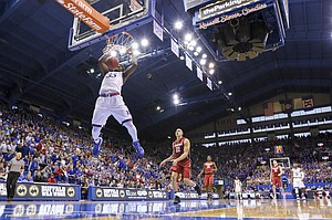 Kansas center Udoka Azubuike (35) powers home a dunk after catching a pass off the backboard from Kansas guard Josh Jackson (11) during the second half on Saturday, Dec. 3, 2016 at Allen Fieldhouse.