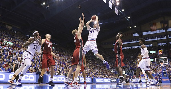 Kansas guard Sviatoslav Mykhailiuk (10) floats in for a shot against Stanford forward Michael Humphrey (10) during the second half on Saturday, Dec. 3, 2016 at Allen Fieldhouse.