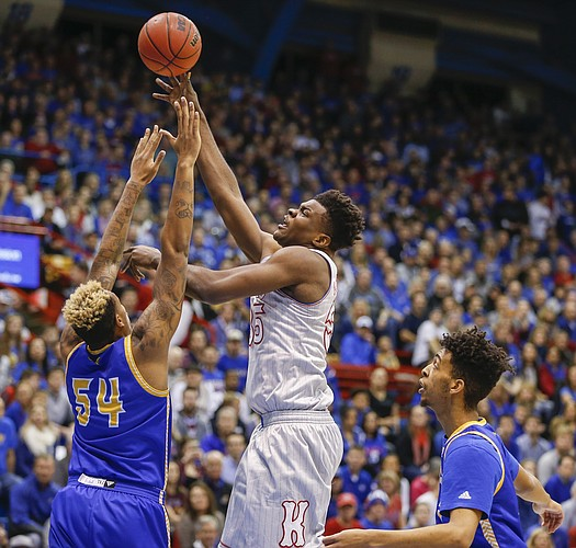 Kansas center Udoka Azubuike (35) puts up a shot over UMKC center Darnell Tillman (54) during the first half, Tuesday, Dec. 6, 2016 at Allen Fieldhouse.