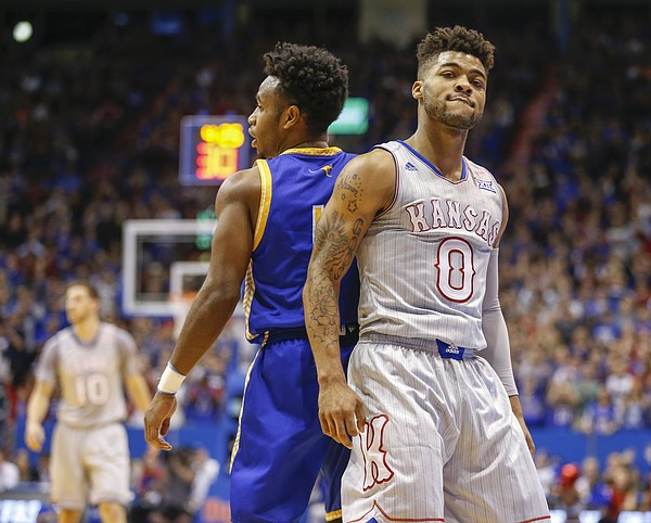 Kansas guard Frank Mason III (0) looks back to the cameras after hitting a three over UMKC guard Dashawn King (1) during the first half, Tuesday, Dec. 6, 2016 at Allen Fieldhouse.