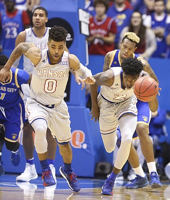 Kansas guard Lagerald Vick (2) charges up the court with a steal next to Kansas guard Frank Mason III (0) during the first half, Tuesday, Dec. 6, 2016 at Allen Fieldhouse.